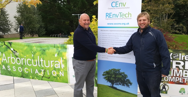 AA CEO Stewart Wardrop congratulates Simon Cox on gaining his CEnv status