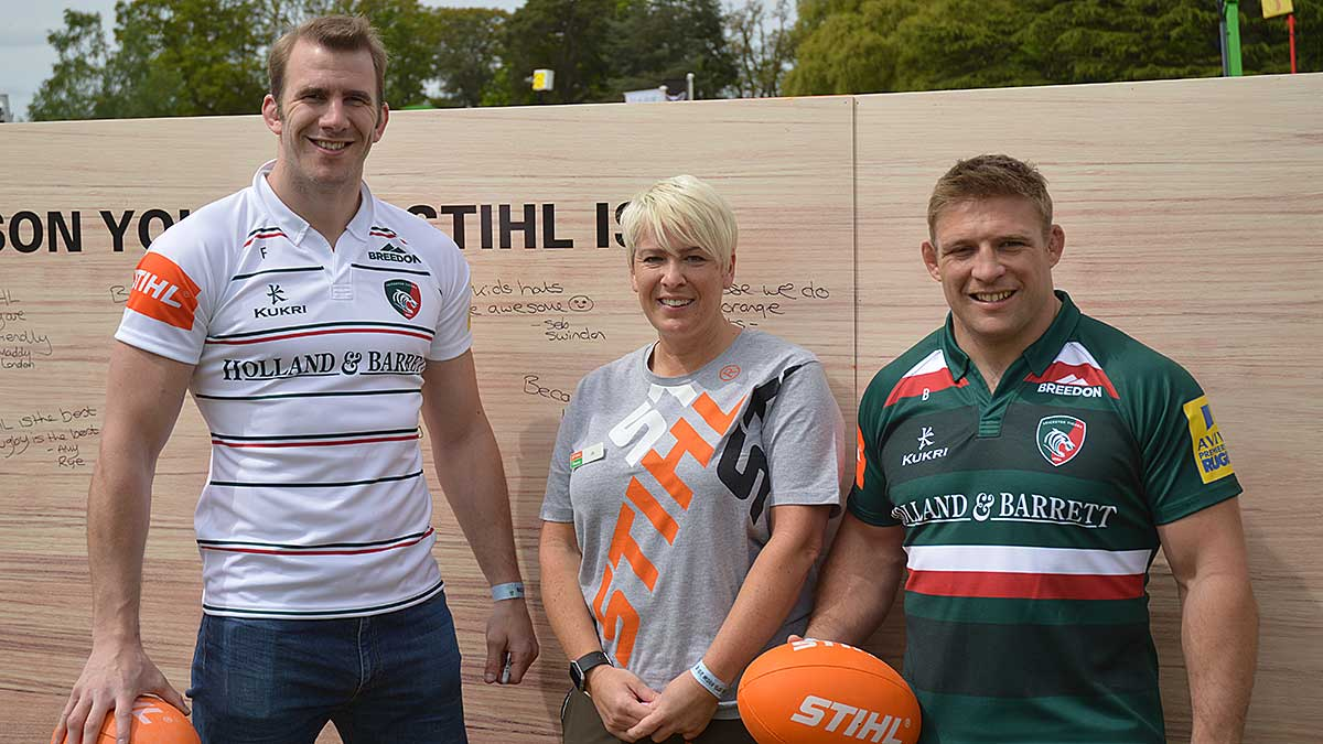 Tom Croft and Tom Youngs signing rugby balls at the STIHL rugby tackle game