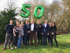 John and son Matt with HQ staff celebrating the company's 50-year anniversary